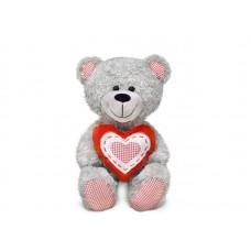 Медведь с красным сердцем - музыкальная игрушка.