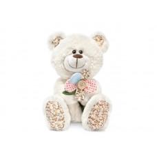 Медвежонок с декоративным цветком - музыкальная игрушка