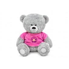 Медвежонок в малиновой кофточке с цветком - музыкальная игрушка.