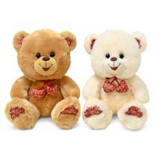 Медведь с декоративными сердечками - музыкальная игрушка.