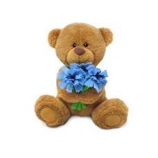 Медвежонок Сэмми с васильками - музыкальная игрушка.