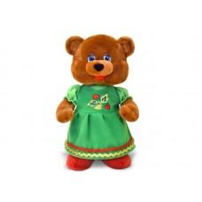 Медведица в зелёном платье танцующая - музыкальная игрушка.