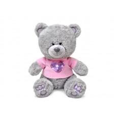Медвежонок Ники в футболке с блестящим сердцем - музыкальная игрушка.