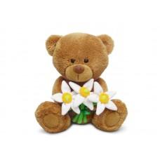 Медвежонок Сэмми с нарциссами - музыкальная игрушка
