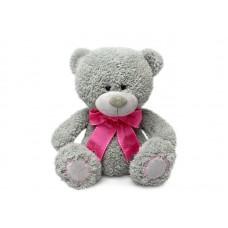 Медвежонок Дэнни с малиновым бантом - музыкальная игрушка.