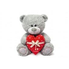 Медвежонок Дэнни с сердцем - музыкальная игрушка.