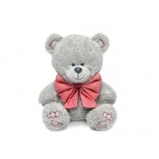 Медвежонок Ники с клетчатым бантом - музыкальная игрушка.