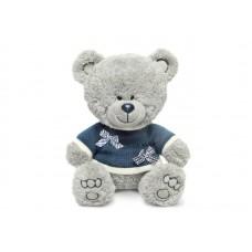 Медвежонок Ники в синей кофточке с бантиками - музыкальная игрушка.