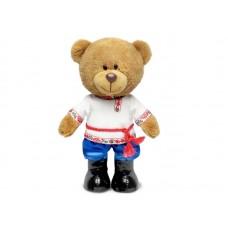 Медведь Оливер в русском наряде - музыкальная игрушка.