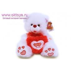 Медведь с розовыми сердечками на пятках