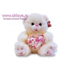 Медведь с розовым сердечком -  музыкальная игрушка