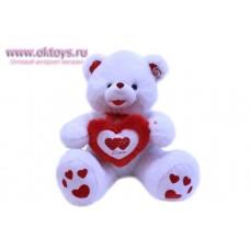 Медведь с красными сердечками на пятках