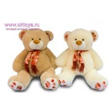 Медведь в шарфе с бахромой и цветами - музыкальная игрушка