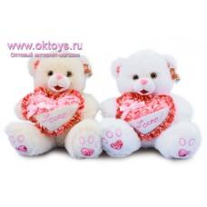 Медведь с бантиком и цветами на сердечке - музыкальная игрушка