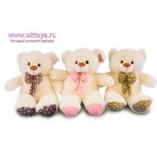 Медведь с бантом и пяточками в горошек - музыкальная игрушка