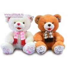 Медведь в шарфе в клеточку и с бахромой - музыкальная игрушка