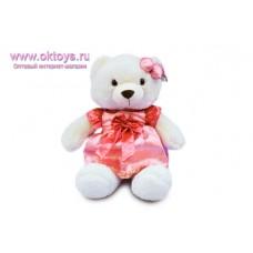 Медведица с розовой заколкой на ушке - музыкальная игрушка