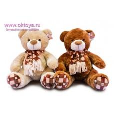 Медведь с шарфом и пятками в коричневую клетку - музыкальная игрушка