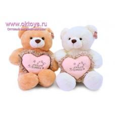Медведь с сердцем с цветной оборкой - музыкальная игрушка