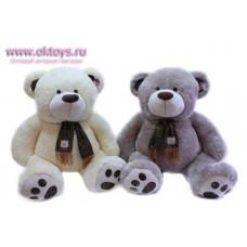 Медведь в шарфе с вышивкой - музыкальная игрушка