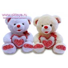 Медведь с розами на сердце и пятках - музыкальная игрушка