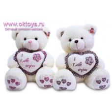 Медведь с сердцем в оборках и с цветочком - музыкальная игрушка