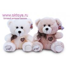 Медведь с бантом и вышитым сердцем - музыкальная игрушка