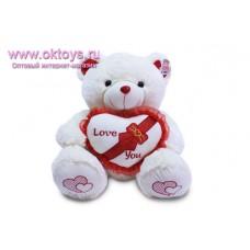 Медведь с сердцем украшенным бантом - музыкальная игрушка
