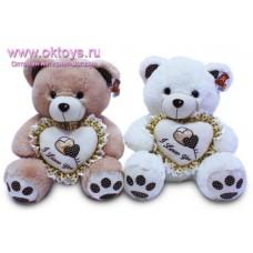 Медведь с сердцем с коричневыми оборками - музыкальная игрушка