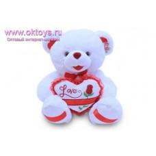 Медведь с сердцем и красной лентой на пятках - музыкальная игрушка
