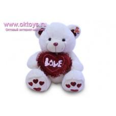 Медведь с бордовым носом и сердечками на пятках