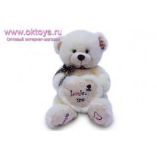Медведь с вышивкой на сердце и пятках - музыкальная игрушка