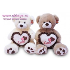 Медведь с сердцем с каймой в горошек - музыкальная игрушка