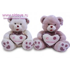 Медведь с сердцем и бантом - музыкальная игрушка