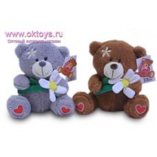 Медведь с большой ромашкой - музыкальная игрушка