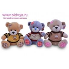 Медведь в свитере с вышивкой