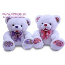 Медведь с бантом и пяточками в цветочек - музыкальная игрушка