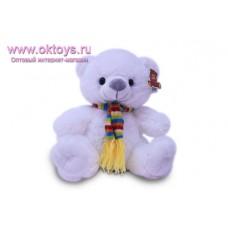Медведь в шарфе в цветную полоску - музыкальная игрушка