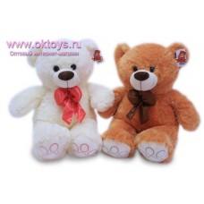 Медведь с шелковым бантом - музыкальная игрушка