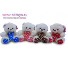 Медвежонок с бантом в горошек - музыкальная игрушка