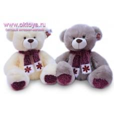 Медведь в пушистом шарфе со снежинкой - музыкальная игрушка