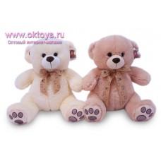 Медведь с фиолетовыми пяточками - музыкальная игрушка