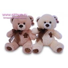 Медведь с бантом и нашивкой-цветком