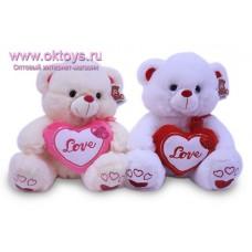 Медведь с украшенным сердечком - музыкальная игрушка