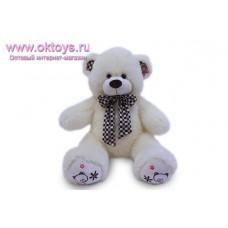 Медведь в шарфе в клетку - музыкальная игрушка