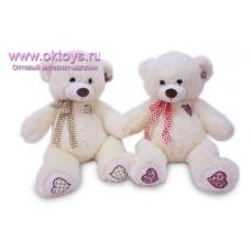 Медведь с ленточкой на шее - музыкальная игрушка