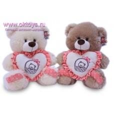 Медведь с сердечком с рисунком и оборками - музыкальная игрушка