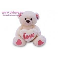 Медведь с пушистым сердцем с надписью *LOVE* - музыкальная игрушка