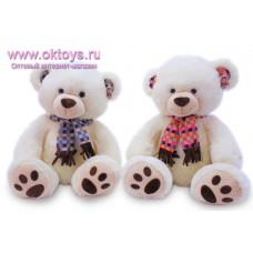 Медведь в шарфе в цветную клетку - музыкальная игрушка
