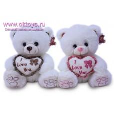 Медведь с бантиком на сердцем - музыкальная игрушка